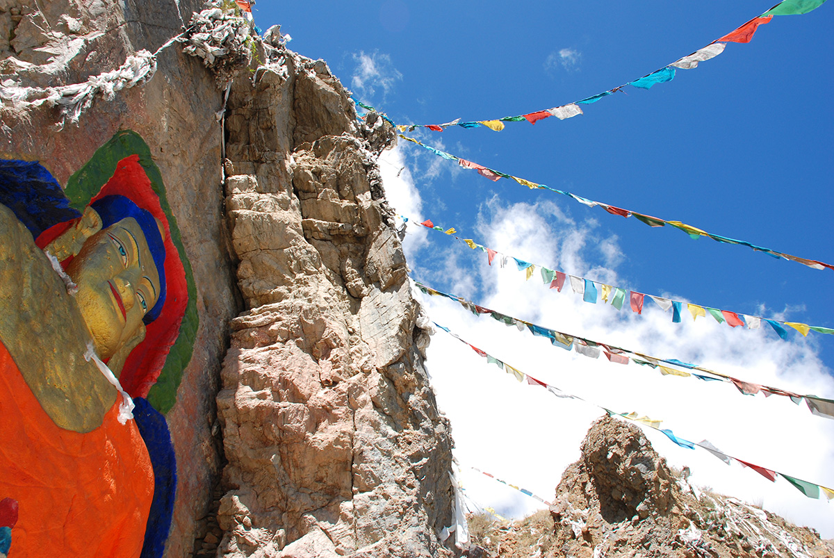Rock Carving and Prayer Flags