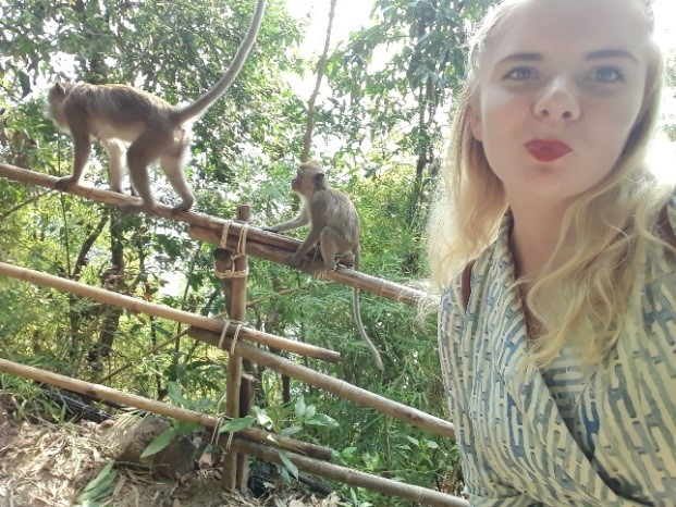 Marika Varga walking past monkeys on her way to work at her placement year in Thailand