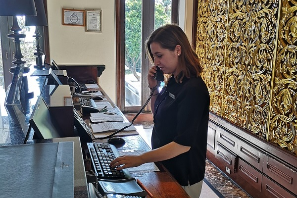 Bianka working on the Front Desk during her Hospitality placement in Thailand with Placement Year International